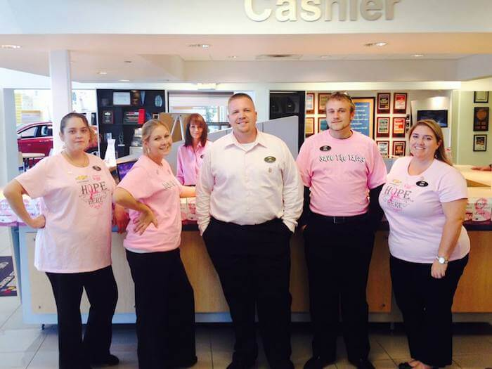 Employees in pink shirts for breast cancer awareness